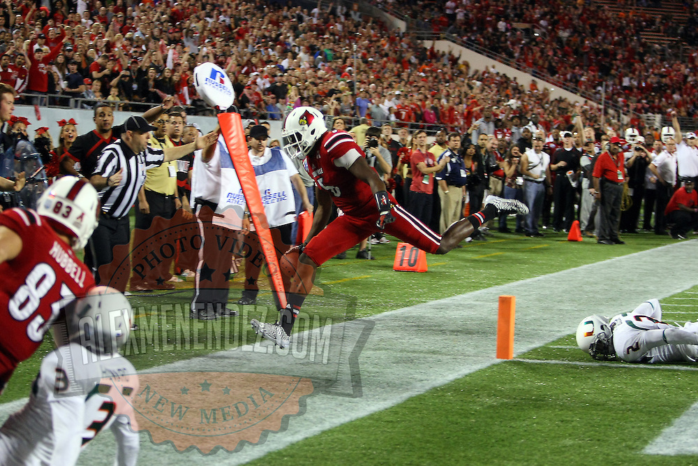 Louisville Cardinals quarterback Teddy Bridgewater (5) scrambles for a touchdown during the NCAA Football Russell Athletic Bowl football game between the Louisville Cardinals and the Miami Hurricanes, at the Florida Citrus Bowl on Saturday, December 28, 2013 in Orlando, Florida. Louisville won the game by a score of 36-9. (AP Photo/Alex Menendez)