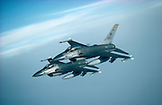 F-16A Falcons in tight formation.