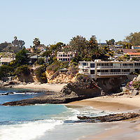 Photo of Laguna Beach homes along the Pacific Ocean. Laguna Beach is a seaside beach city in Orange County in Southern California.