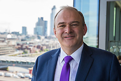 London, UK. 30 May, 2019. Ed Davey, Liberal Democrat MP for Kingston and Surbiton and former Secretary of State for Energy and Climate Change, poses on a balcony after making a speech in central London to launch his campaign for the party leadership following excellent results for the party in the recent European and local elections.