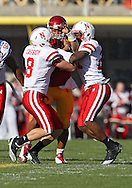 November 06 2010: Iowa State Cyclones quarterback Austen Arnaud (4) is hit by Nebraska Cornhuskers safety Austin Cassidy (8) and Nebraska Cornhuskers cornerback Prince Amukamara (21) during the first half of the NCAA football game between the Nebraska Cornhuskers and the Iowa State Cyclones at Jack Trice Stadium in Ames, Iowa on Saturday November 6, 2010. Nebraska defeated Iowa State 31-30.