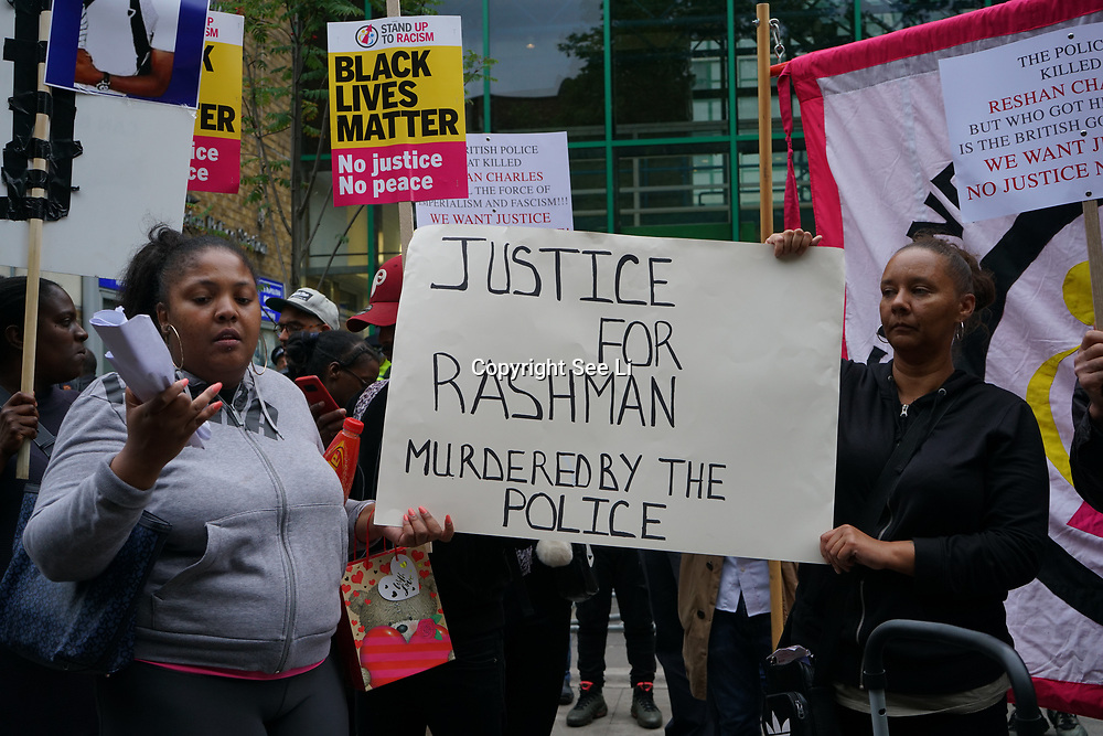 Stoke Newington Police Station. Hackney. London, UK. 24th July 2017. Campaigners hold a vigil outside Stoke Newington Police Station in Hackney, East London, demanding 'justice' for Rashan Charles who died after being chased by police officers in the early hours of 22 July.