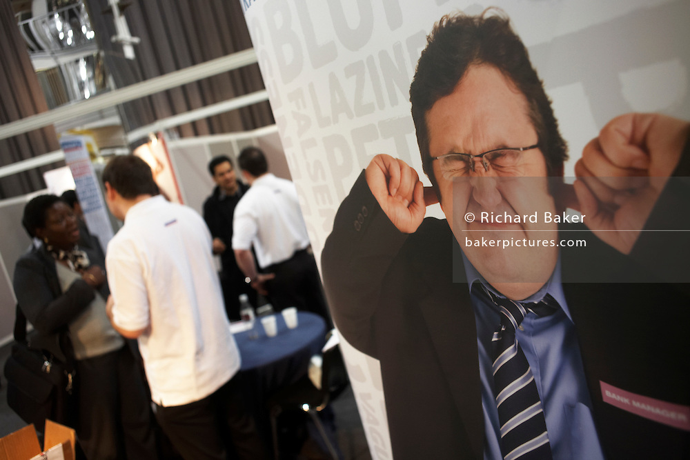 Young job-seekers get advice at a graduate expo fair where company job recruiters meet young people starting work