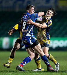 Ryan Mills of Worcester Warriors tackles Tavis Knoyle of Newport Gwent Dragons - Mandatory by-line: Robbie Stephenson/JMP - 16/12/2016 - RUGBY - Rodney Parade - Newport, Wales - Newport Gwent Dragons v Worcester Warriors - European Rugby Challenge Cup