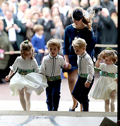 Lady Louise Mountbatten-Windsor escorts the bridesmaids and page boys, including Prince George and Princess Charlotte (right), as they arrive for the wedding of Princess Eugenie to Jack Brooksbank at St George's Chapel in Windsor Castle.