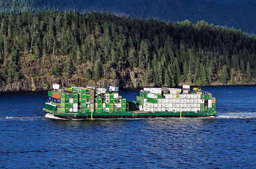 Barge carries supplies, equipment and autos up the Campbell river to Ketchikan, Alasksa, USA