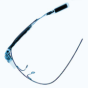 X-Ray of Google Glass.  Google Glass is a wearable computer with an optical head-mounted display (OHMD). It was developed by Google with the mission of producing a mass-market ubiquitous computer. Google Glass displays information in a smartphone-like hands-free format. Wearers communicate with the Internet via natural language voice commands. Google Glass became officially available to the general public on May 15, 2014, for a price of $1500.