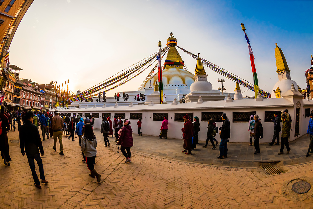 Buddhist pilgrims circumambulate the massive Boudhanath Stupa (the largest stupa in Nepal and the holiest Tibetan Buddhist temple outside Tibet.) The Boudhanath Temple is the center of Tibetan culture in Kathmandu, Nepal.