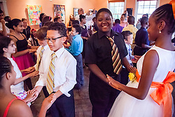 """Jasai George, left, and Aiden Liburd, right ask their partners to dance.  Students of Dancing Classrooms of the Virgin Islands dance at a reception for their parents, family community, and school partners at the Virgin Islands Council on the Arts.  Students spent weeks learning the Tango, Foxtrot, Meringue, Swing, Rumba, and Waltz that will culminate in """"Colors of the Rainbow"""" team match competition at Reichhold Center for the Arts on Saturday, May 9, 2015.  St. Thomas, USVI.  8 May 2015.   © Aisha-Zakiya Boyd"""