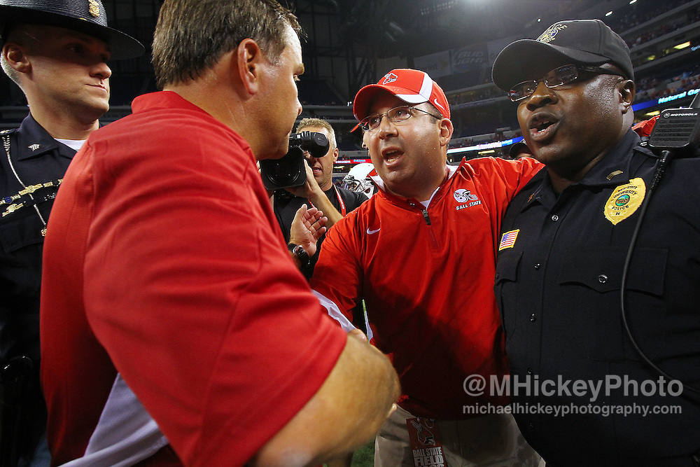 Sept. 03, 2011; Indianapolis, IN, USA; Indiana Hoosiers head coach Kevin Wilson greets Indiana Hoosiers head coach Kevin Wilson after defeating the Indiana Hoosiers at Lucas Oil Stadium.<br /> Mandatory credit: Michael Hickey-US PRESSWIRE