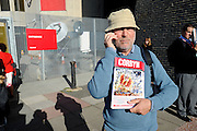 Labour Party Annual Conference<br /> Brighton<br /> 27-30 September<br /> Political activist distributing literature at the entrance to the conference hall.