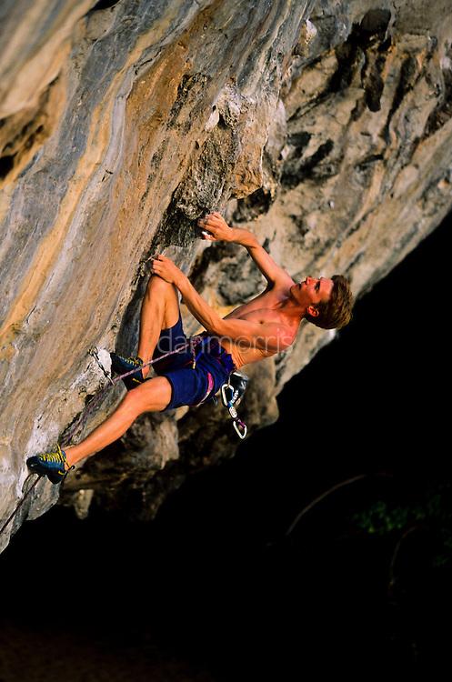 Frenchman Arnaud Petit climbing Voodoo Doll, 7c+, Tonsai Beach, Thailand