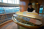 Aboard the Rhapsody of the Seas, on a cruise from Vancouver to Hawaii. A model of the ship with deck plan.