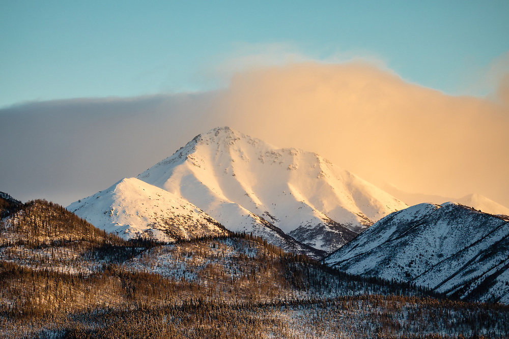 Late afternoon light on mountains along the Tok Cutoff Highway in Interior Alaska. Winter.