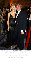 Multi-millionaire businessman ROBERT TCHENGUIZ and HEATHER BIRD at a ball in London on 22nd November 2003.POU 239