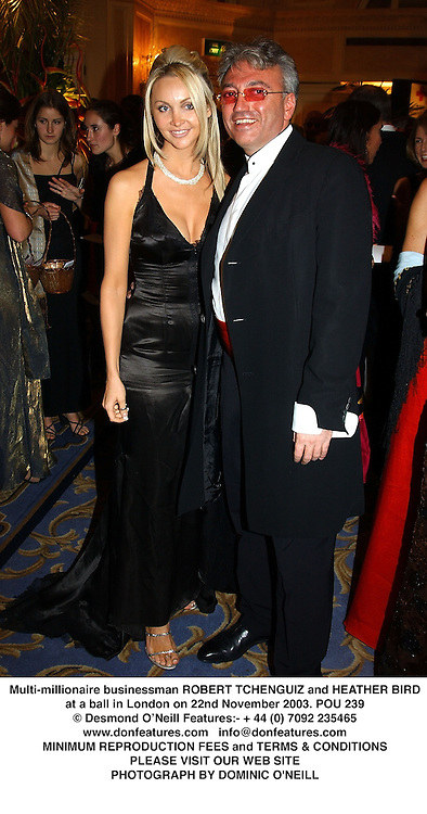 Multi-millionaire businessman ROBERT TCHENGUIZ and HEATHER BIRD at a ball in London on 22nd November 2003.POU 239