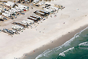 Recreational vehicles, better known as RVs, sit parked along this Florida beach. In 2007, nearly 8 million U.S. households owned at least one RV.  Typically, the fuel economy of RVs is less than 10 miles per gallon.