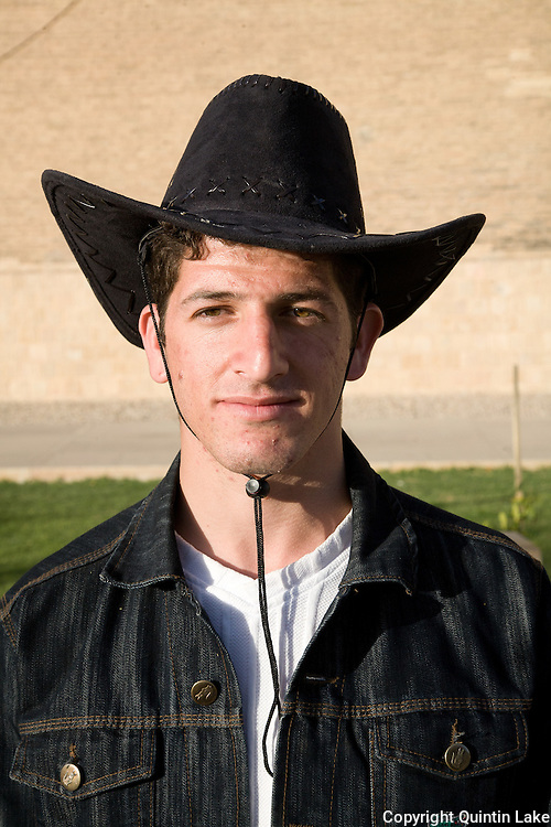 Portrait of a young Iranian man wearing a cowboy hat Shiraz, Iran