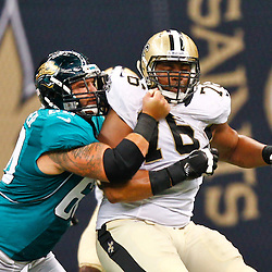August 17, 2012; New Orleans, LA, USA; New Orleans Saints defensive end Akiem Hicks (76) is blocked by Jacksonville Jaguars center Michael Brewster (60) during the second half of a preseason game at the Mercedes-Benz Superdome. The Jaguars defeated the Saints 27-24.  Mandatory Credit: Derick E. Hingle-US PRESSWIRE