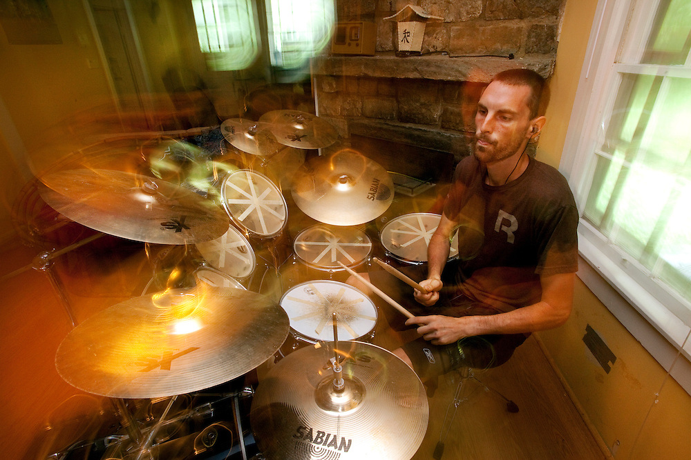 Zap athlete Dave Jankowski plays the drums during down time in Blowing Rock, NC. .