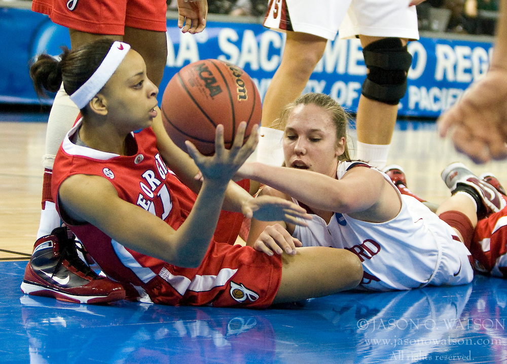 March 27, 2010; Sacramento, CA, USA; Georgia Bulldogs guard Ashley Houts (1) grabs a loose ball from Stanford Cardinal forward Kayla Pedersen (14) during the first half in the semifinals of the Sacramental regional in the 2010 NCAA womens basketball tournament at ARCO Arena. Stanford defeated Georgia 73-36.