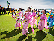 "28 AUGUST 2014 - BANGKOK, THAILAND: Thai dancers perform during the opening ceremonies at the King's Cup Elephant Polo Tournament at VR Sports Club in Samut Prakan on the outskirts of Bangkok, Thailand. The tournament's primary sponsor in Anantara Resorts. This is the 13th year for the King's Cup Elephant Polo Tournament. The sport of elephant polo started in Nepal in 1982. Proceeds from the King's Cup tournament goes to help rehabilitate elephants rescued from abuse. Each team has three players and three elephants. Matches take place on a pitch (field) 80 meters by 48 meters using standard polo balls. The game is divided into two 7 minute ""chukkas"" or halves.      PHOTO BY JACK KURTZ"