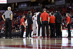 10 January 2018:  Bret Smith looks on a Redbird timeout huddle during a College mens basketball game between the Loyola Chicago Ramblers and Illinois State Redbirds in Redbird Arena, Normal IL