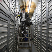 WASHINGTON, DC-OCT14: John Charles, 23, leaves his storage unit at Capital Self-Storage, October 16, 2015. Many of the area homeless have possessions they want to keep safe, just nowhere permanent to live, so they store their belongings at Capital Self-Storage, where an upper-level unit costs $30/month. Some of the homeless patrons also spend their days in their storage units, when shelters are closed during midday hours. The storage facility near 3rd and Florida Avenue in Northeast, Washington, DC, is about to be replaced by a boutique hotel. (Photo by Evelyn Hockstein/For The Washington Post)