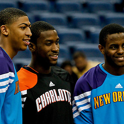 October 9, 2012; New Orleans, LA, USA; Former teammates with the Kentucky Wildcats New Orleans Hornets forward Anthony Davis (23), Charlotte Bobcats forward Michael Kidd-Gilchrist (14) and Hornets forward Darius Miller (2) pose for a picture together before tip off of a preseason game at the New Orleans Arena. The Hornets defeated the Bobcats 97-82.  Mandatory Credit: Derick E. Hingle-US PRESSWIRE