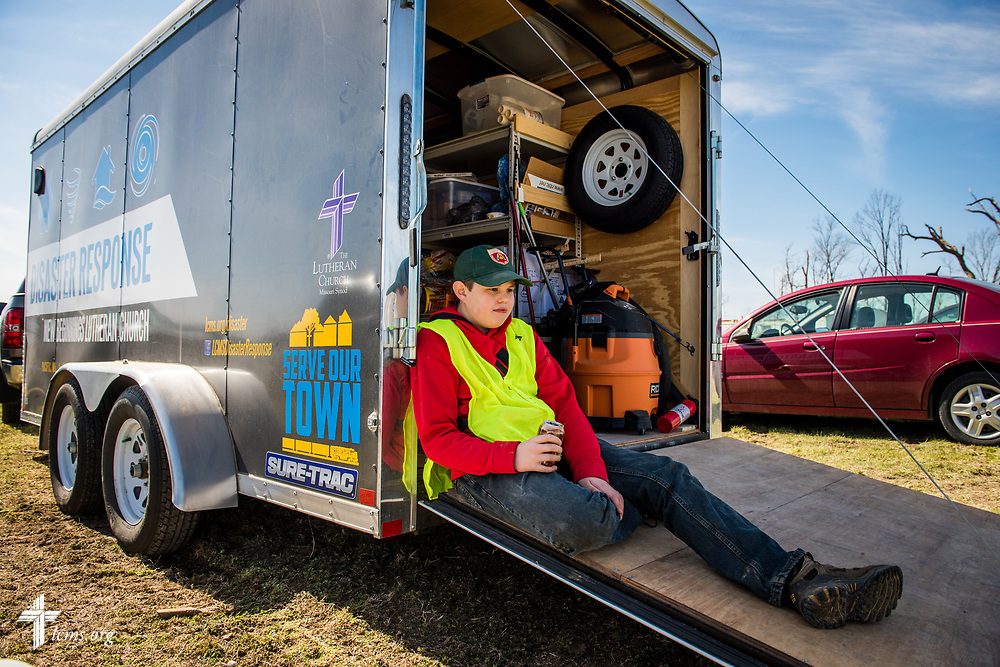 Lutheran volunteer Dominic Adams rests against a disaster trailer from New Beginnings Lutheran Church, Pacific, Mo., during cleanup at a destroyed home on Saturday, March 4, 2017, in Perryville, Mo. LCMS Communications/Erik M. Lunsford