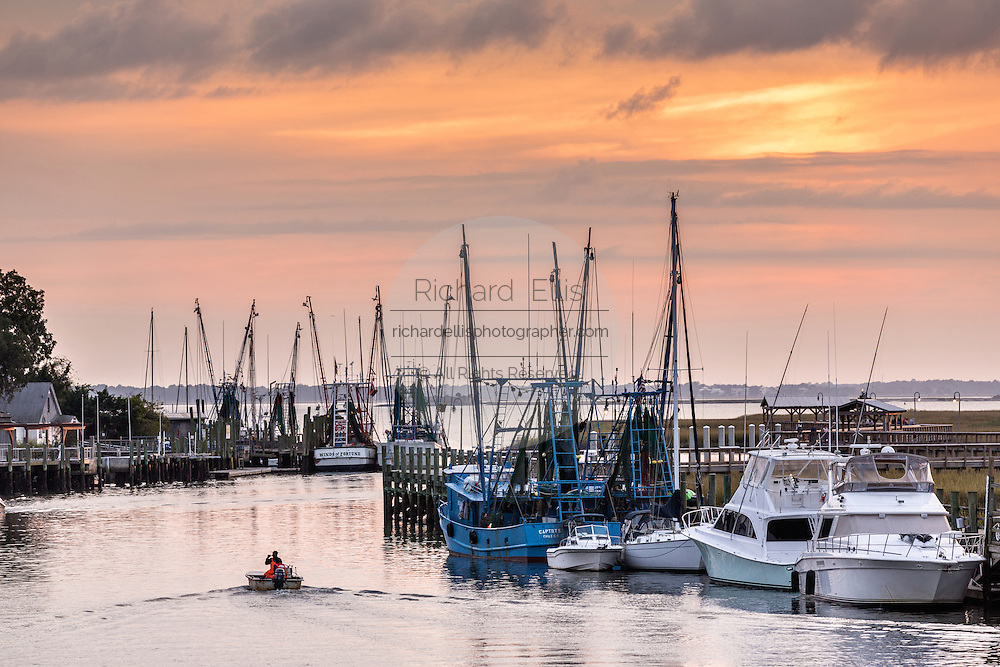 Shrimp boats docked along Shem Creek at sunset in Mount Pleasant, South Carolina.