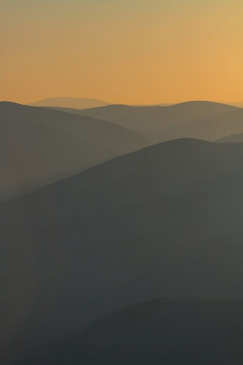 Rolling hills over Upper Tweedale from Broughton Heights at dusk
