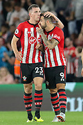 GOAL - Southampton midfielder Pierre-Emile Hojbjerg (23) is congratulated by Southampton striker Danny Ings (9) during the Premier League match between Southampton and Brighton and Hove Albion at the St Mary's Stadium, Southampton, England on 17 September 2018.