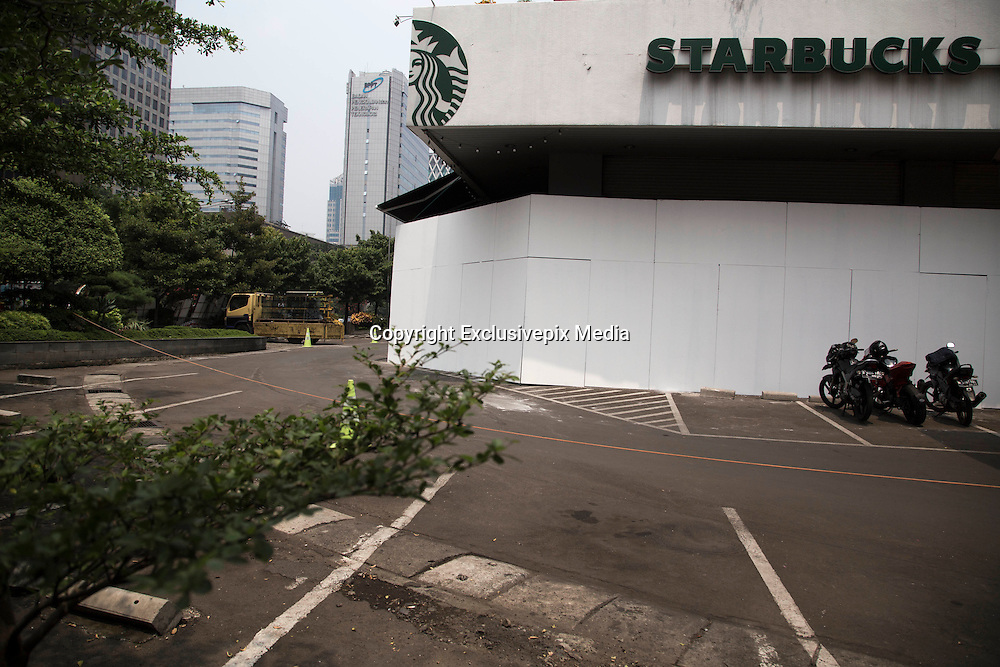 Jakarta, Indonesia 17 January 2016 : <br /> <br /> Starbucks Coffee after the bomb. Jakarta back to normal again after the fatal attack at Starbuck Coffee at Thamrin Street. Peoples still visiting to the bombing site to take photos and condemn to the terrorist action.<br /> ©Exclusivepix Media