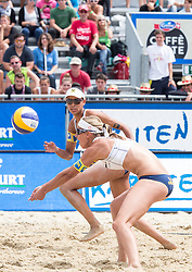 30.07.2014, Strandbad, Klagenfurt, AUT, FIVT, A1 Beachvolleyball Grand Slam 2014, Hauptrunde, im Bild Stefanie Schwaiger (AUT, vorne) und Lisa Chukwuma (AUT, hinten) // during Main Draw Match of the A1 Beachvolleyball Grand Slam at the Strandbad Klagenfurt, Austria on 2014/07/30. EXPA Pictures © 2014, EXPA Pictures © 2014, PhotoCredit: EXPA/ Johann Groder