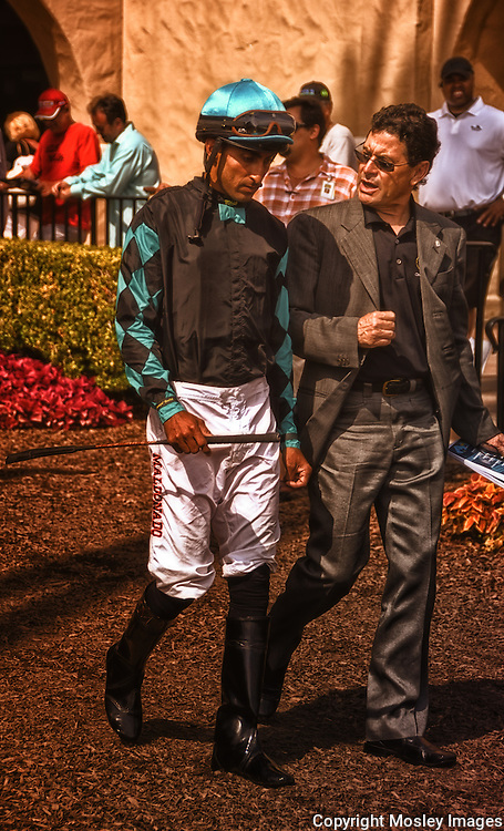 Professional Jockey Edwin Maldonado walks to Del Mar Paddock with unknown advisor. Captured by Lincoln Nebraska sports photographer Barry A Mosley.