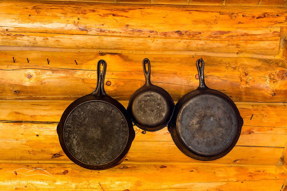 Cast iron skillets on the wall in the Bridge Cabin at Bowlin Camps near Patten, Maine, and Katahdin Woods and Waters National Monument.