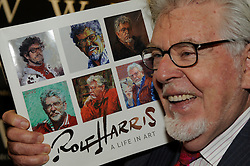 "© Licensed to London News Pictures. 19/04/2013.Rolf Harris has been named as the veteran entertainer who was arrested by police investigating allegations of sexual abuse following the Jimmy Savile scandal..Harris, 83, a former resident of Sydenham, was originally interviewed by detectives from Scotland Yard's Operation Yewtree in November 2012 and was then arrested over the allegations on March 28 2013..(File Image 27.11.2010). Rolf Harris at Waterstones book store at the Bluewater Shopping complex in Kent.  . launching his new book. Rolf Harris ""A Life in Art"".. Photo credit : Grant Falvey/LNP"
