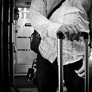 Der Zug ist schon im Stadtgebiet von Wien, noch wenige Momente und der Westbahnhof ist erreicht. Auf dem Bahnhof will M den Rollkoffer los werden, alles was ihm wichtig ist passt in eine kleine Herren-Handtasche. Die Tasche ist seit Reutte ein st&auml;ndiger Begleiter.<br /> &copy; 2013 Harald Krieg/Agentur Focus