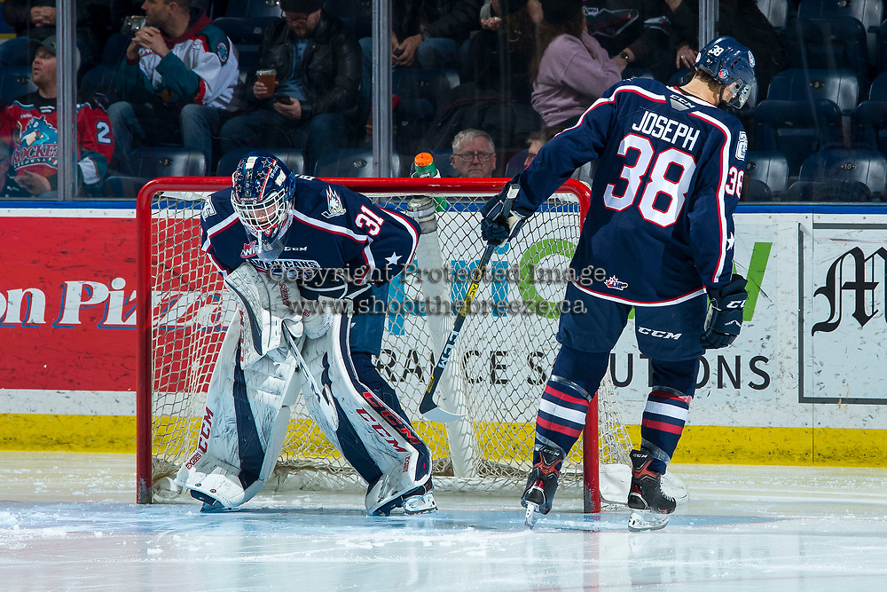 KELOWNA, BC - FEBRUARY 12: Jadon Joseph #38 taps the pads of goaltender Talyn Boyko #31 of the Tri-City Americans to start second period against the Kelowna Rockets at Prospera Place on February 8, 2020 in Kelowna, Canada. (Photo by Marissa Baecker/Shoot the Breeze)