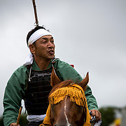 "MINAMISOMA, JAPAN - JULY 24 : A samurai horseman is seen while he compete in the Shinki-soudatsusen (sacred flag competition) during the Soma Nomaoi festival at Hibarigahara field on Sunday, July 24, 2016 in Minamisoma, Japan. ""Soma-Nomaoi"" is a traditional festival that recreates a samurai battle scene from more than 1,000 years ago.  (Photo: Richard Atrero de Guzman/NURPhoto)"