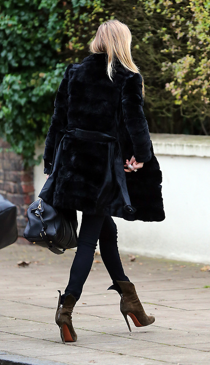 Supermodel Kate Moss wearing a black fur coat, stripy top, black skinny jeans and green suede boots out and about in London, UK. 01/12/2014<br />