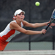 Hailey Swenson, in orange and white of Murray competes with Amanda Jensen in blue of Woods Cross in the number one singles of the 4A state Tennis Championships at Liberty Park in Salt Lake City, Utah , Saturday, Oct. 8, 2005. August Miller/ Deseret Morning News