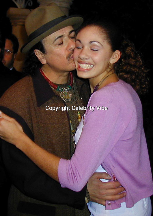 Carlos Santana and Daughter<br />Arista Records Pre Grammy Bash Hosted By Clive Davis<br />Beverly Hills Hotel<br />Los Angeles, California, USA<br />Tuesday,February 22, 2000<br />Photo By Celebrityvibe.com/Photovibe.com