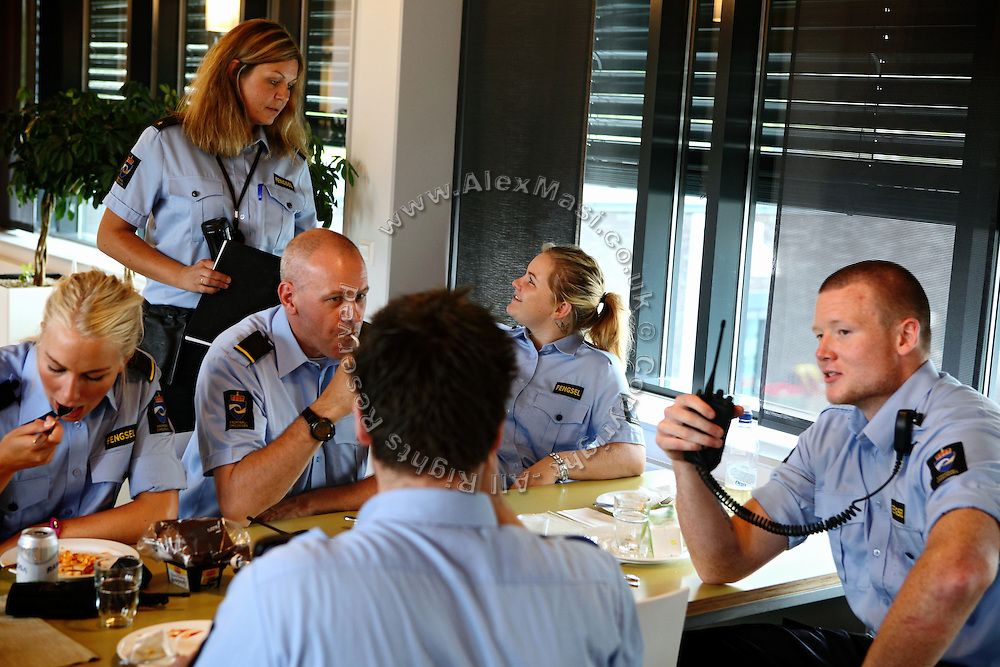 Guards are eating and chatting in the lunch room of the luxurious Halden Fengsel, (prison) near Oslo, Norway.
