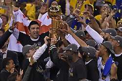 June 12, 2017 - Oakland, CA, USA - The Golden State Warriors celebrate as they hold the championship trophy after defeating the Cleveland Cavaliers, 129-120, in Game 5 of the NBA Finals at Oracle Arena in Oakland, Calif., on Monday, June 12, 2017. (Credit Image: © Jose Carlos Fajardo/TNS via ZUMA Wire)