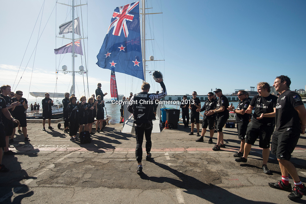 Emirates Team New Zealand sailors leave the base for day 14 of America's Cup 34. 24/9/2013