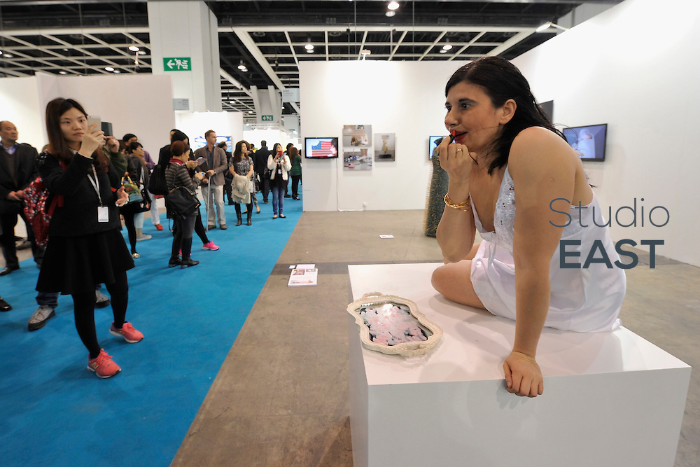HONG KONG - MARCH 13:  Artist Nezaket Ekici perfoms artistic performance 'Emotion in Motion' in art fair Art Basel on its preview day on March 13, 2015 in Hong Kong, Hong Kong.  (Photo by Lucas Schifres/Getty Images)
