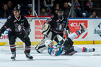 KELOWNA, CANADA - FEBRUARY 14: Leif Mattson #28 of the Kelowna Rockets falls to the ice after getting caught up with Riley Lamb #33 of the Red Deer Rebels on February 14, 2018 at Prospera Place in Kelowna, British Columbia, Canada.  (Photo by Marissa Baecker/Shoot the Breeze)  *** Local Caption ***