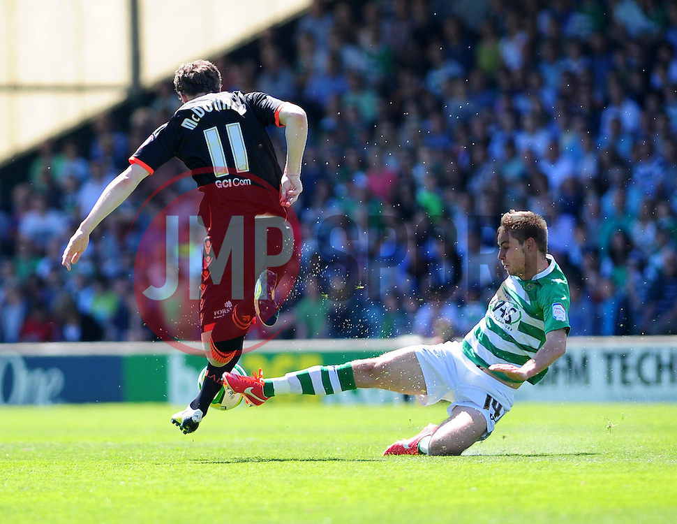 Yeovil Town's Sam Foley tackles Sheffield United's Kevin McDonald - Photo mandatory by-line: Dougie Allward/JMP - Tel: Mobile: 07966 386802 06/05/2013 - SPORT - FOOTBALL - Huish Park - Yeovil - Yeovil Town V Sheffield United - NPOWER LEAGUE ONE PLAY-OFF SEMI-FINAL SECOND LEG